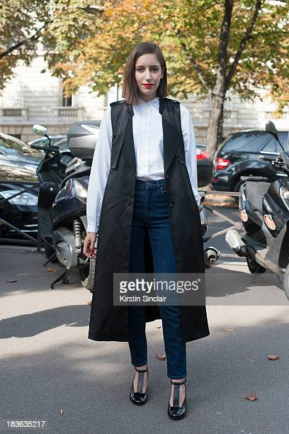 Laetitia Roukbi wearing Cos jeans Kenzo shirt Robert Clergerie shoes and an H and M coat on day 9 of Paris Fashion Week Spring/Summer 2014 Paris...