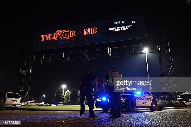 Lafayette police stand outside of the Grand Theater on July 23 2015 in Lafayette Louisiana Three people are dead and seven more injured after a...