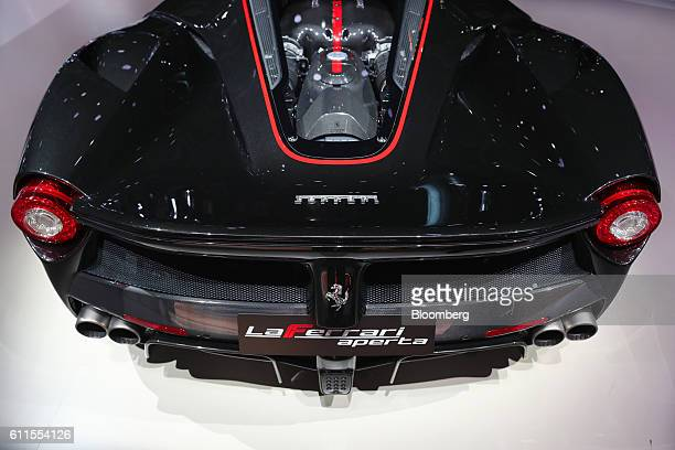 LaFerrari Aperta automobile, produced by Ferrari NV, sits on the company's stand during the second press day of the Paris Motor Show at Porte de...