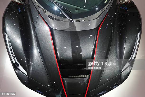 LaFerrari Aperta automobile, produced by Ferrari NV, sits on the company's during the second press day of the Paris Motor Show at Porte de Versailles...