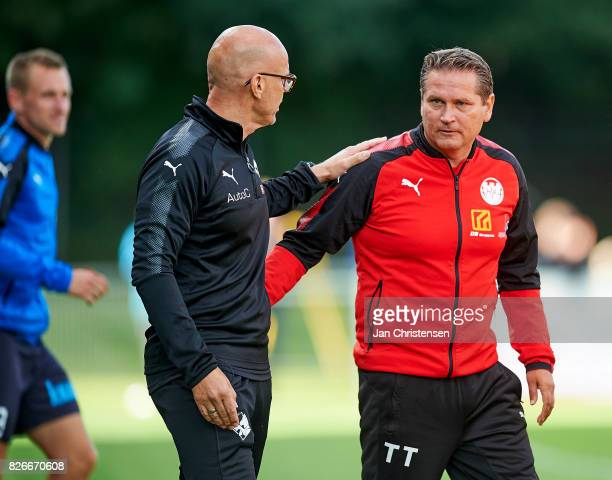 Ólafur Kristjánsson head coach of Randers FC and Thomas Thomasberg head coach of Hobro IK shake hands after the Danish Alka Superliga match between...