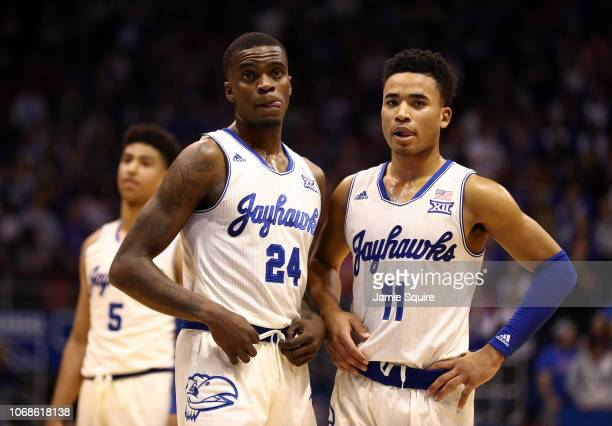 Lagerald Vick and Devon Dotson of the Kansas Jayhawks wait during a timeout in the game against the Louisiana Lafayette Ragin Cajuns at Allen...