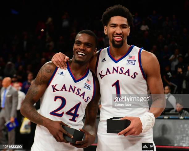 Lagerald Vick and teammate Dedric Lawson of the Kansas Jayhawks smile after receiving awards after Kansas' 8781 win over Tennessee Volunteers at the...