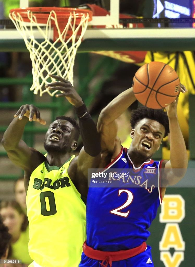 Lagerald Vick #2 of the Kansas Jayhawks and Jo Lual-Acuil Jr. #0 of the Baylor Bears compete for a rebound in the second half at the Ferrell Center on February 18, 2017 in Waco, Texas. Kansas won 67-65.