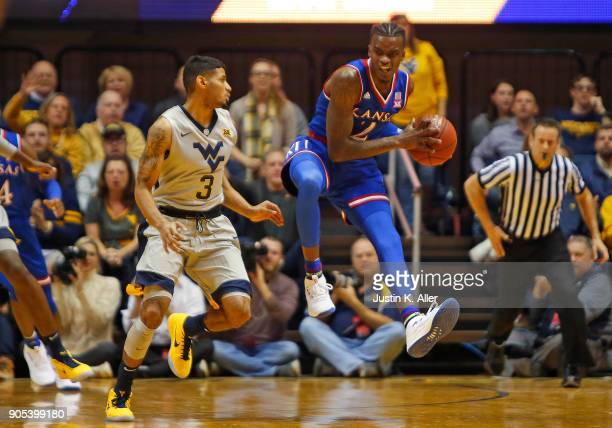 Lagerald Vick of the Kansas Jayhawks catches an inbound pass against James Bolden of the West Virginia Mountaineers at the WVU Coliseum on January 15...