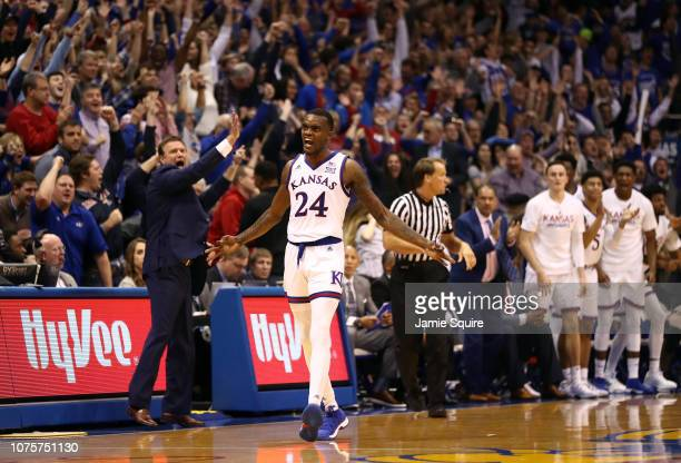 Lagerald Vick of the Kansas Jayhawks celebrates after making a threepointer in the final seconds of the game against the Stanford Cardinal to send it...