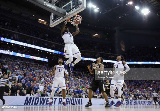 Lagerald Vick of the Kansas Jayhawks dunks the ball in the first half against the Purdue Boilermakers during the 2017 NCAA Men's Basketball...