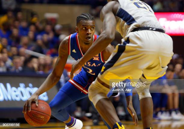 Lagerald Vick of the Kansas Jayhawks looks to pass against the West Virginia Mountaineers at the WVU Coliseum on January 15 2018 in Morgantown West...