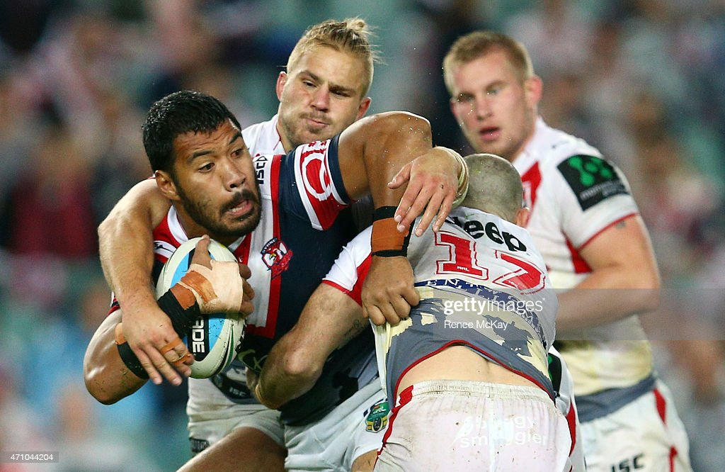 Lagi Setu of the Roosters is tackled by Heath L'Estrange and Jack de Belin of the Dragons during the round eight NRL match between the Sydney Roosters and the St George Illawarra Dragons at Allianz Stadium on April 25, 2015 in Sydney, Australia.