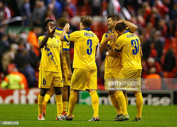 Laglais Kouassi, Veroljub Salatic, Reto Ziegler and Elsad Zverotic of FC Sion high five at the end of the match during the UEFA Europa League group B...