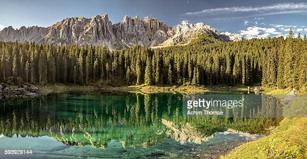 lago di carezza - dolomite alps, south tyrol, italy - reflection lake stock photos and pictures