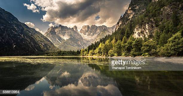lago di landro dürrensee , italy - reflection lake stock photos and pictures