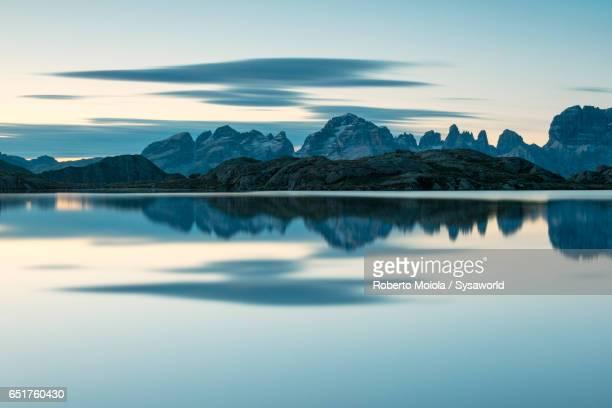 lago nero at dawn cornisello dolomites italy - trento foto e immagini stock