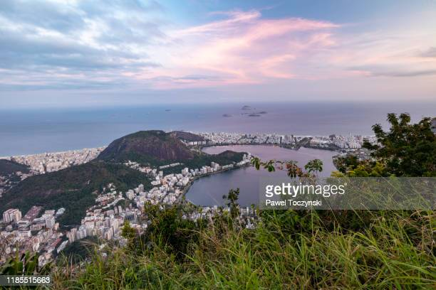lagoa and ipanema districts rio de janeiro seen from corcovado at sunset, brazil - botafogo brazil stock pictures, royalty-free photos & images