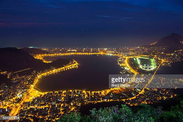 Lagoa Rodrigo de Freitas and surroundings including Jardim Botanico neighborhood and Jockey Club Brasileiro seen from Christ the Redeemer at night...