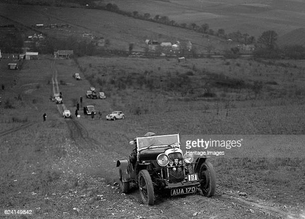 Lagonda Rapier competing in the London Motor Club Coventry Cup Trial Knatts Hill Kent 1938 Artist Bill BrunellLagonda Rapier 1104 cc Vehicle Reg No...