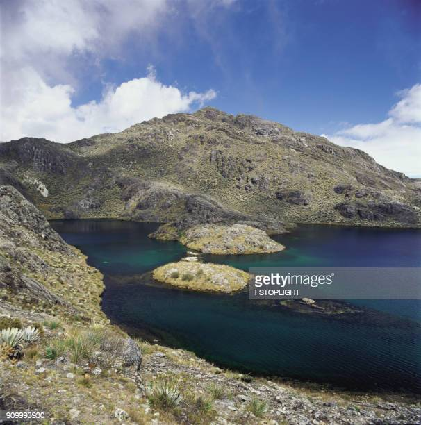 lagoon and mountain - fstoplight stock photos and pictures