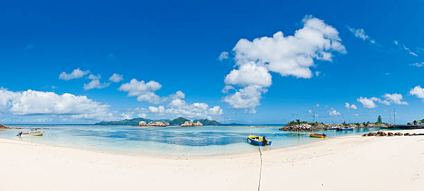 Lagoon beach harbor idyllic tropical island sandy ocean shore panorama