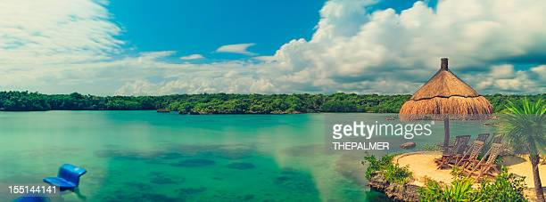 lagoon in mexico panorama - mayan riviera stock photos and pictures