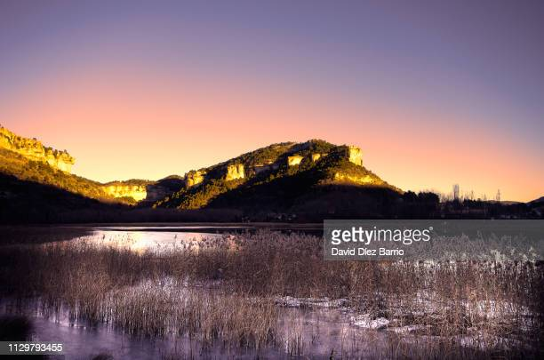Lagoon of 'Uña' icy at sunset with mountains in the background