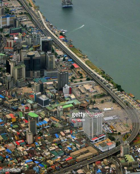 lagos central business district, waterfront - lagos island, nigeria - lagos nigeria stock pictures, royalty-free photos & images