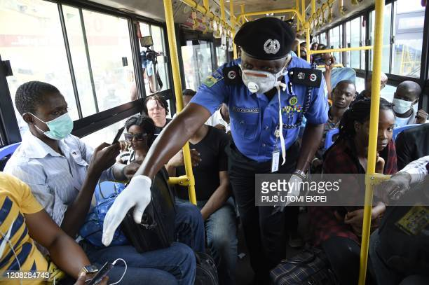 Lagos Commissioner of Police, Hakeem Odumosu , speaks to passengers to enforce social distancing in a bus as part of measures to curb the spread of...