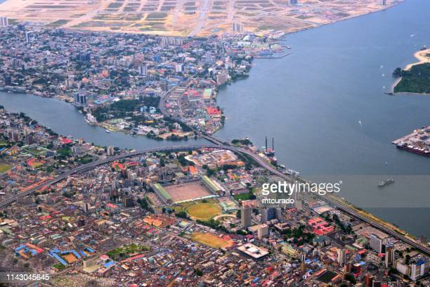 lagos from the air - lagos island and victoria island - central business district - lagos lagoon and five cowrie creek, nigeria - nigeria stock pictures, royalty-free photos & images