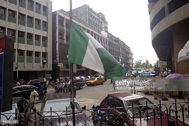 A Nigerian flag flies at half mast at a Lagos public building 24 October 2005 The Nigerian government has declared a threeday national mourning in...
