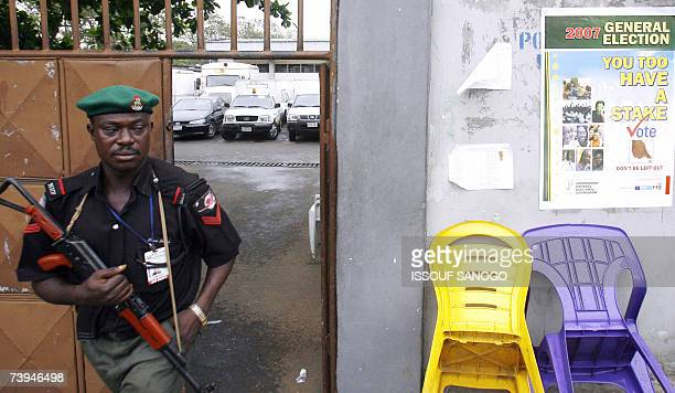 A Nigerian policeman leaves the Independent Electoral Commission headquarters 22 April 2007 in Lagos where forces were deployed on the eve of the...
