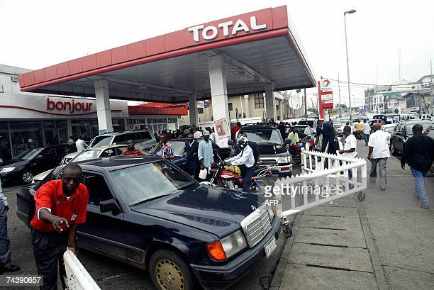 Motorists and public motocyclists queue to buy fuel at station as petroleum tankers began strike in Lagos 04 June 2007 Nigeria's central labour union...
