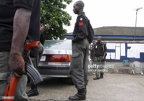 Nigerian policemen are deployed at the Independent Electoral Commission headquarters 22 April 2007 in Lagos on the eve of the results announcement of...