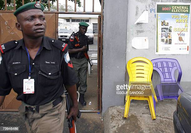 Nigerian policemen leave the Independent Electoral Commission headquarters 22 April 2007 in Lagos where forces were deployed on the eve of the...