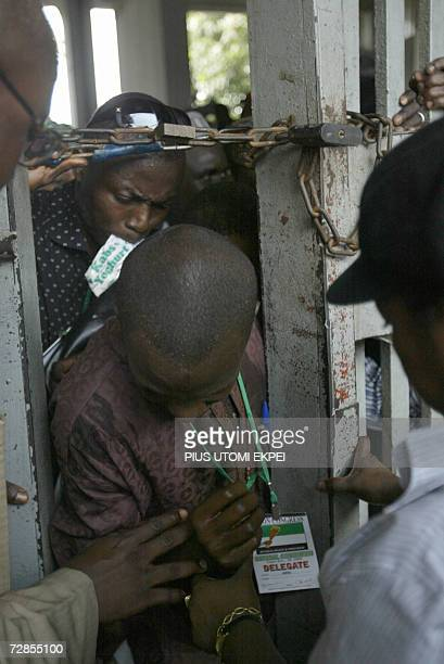 Party delegates squeeze through a narrow passage created by security operatives in Tafawa Balewa Square in Lagos 20 December 2006 where Nigerian Vice...
