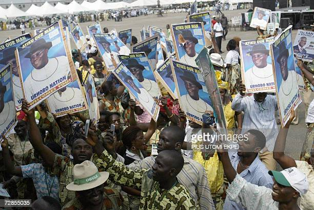Supporters dance with posters of Nigerian Vice President Atiku Abubakar 20 December 2006 in Tafawa Balewa Square in Lagos where the politician came...