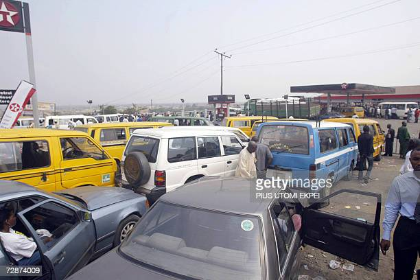 Vehicles queue for fuel at a Texaco filling station on the LagosIbadan highway 24 December 2006 Fuel scarcity has hit Lagosians already in festive...