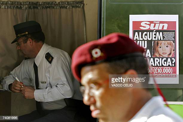 A poster displaying the today's front page of the British newspaper The Sun is seen on a police van outside the Ocean club apartment hotel in Praia...