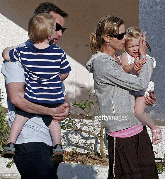 Gerald McCann and Kate McCann parents of missing threeyear old British girl Madelaine McCann walk holding their two other children outside the Ocean...