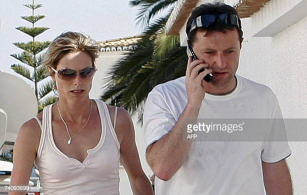 Gerry and Kate McCann parents of the abducted British threeyearold Madeleine McCann walk in Praia da Luz southern Portugal 07 May 2007 Kate McCann...