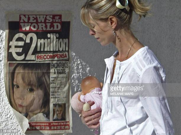 Kate McCann mother of Madeleine who disappeared 11 days ago in Portugal's southern Algarve region passes next to a poster displaying police and news...