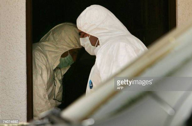 Portuguese special police search a room for missing 3year old British girl Madelaine McCann 04 May 2007 in the Ocean club appartement hotel in Praia...