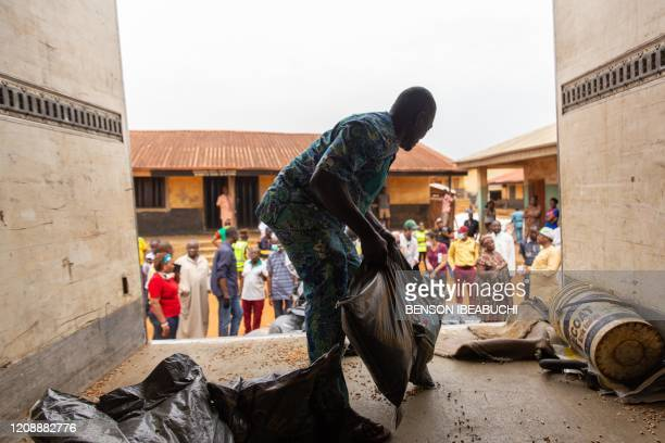 Lagos State Officials unloading the food bags that will be distributed to people of the Agbado and OkeOdo LCDA in Lagos on April 1 2020 More than 20...