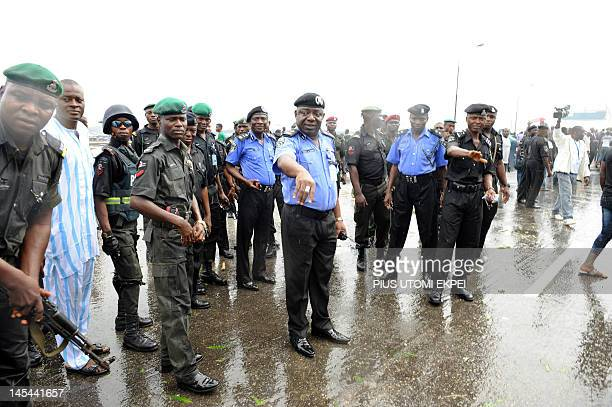 Lagos State police boss Umar Manko directs affair as the students of the University of Lagos protest on May 30, 2012 the name change of their...