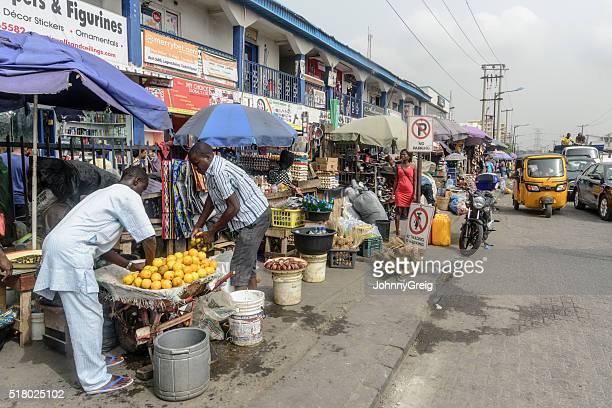 lagos street market - lagos stock photos and pictures