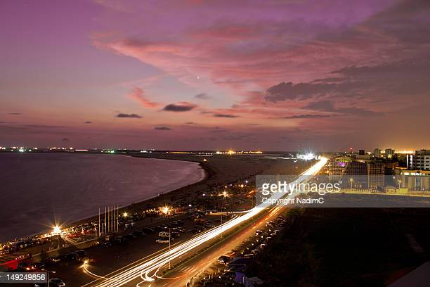 lagos sunset (bar beach) - nigeria stock pictures, royalty-free photos & images