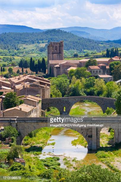 lagrasse, abbey of sainte marie de lagrasse also saint d orbieu in the corbieres wine-growing region, department of aude, languedoc-roussillon, france - abbey monastery stock pictures, royalty-free photos & images