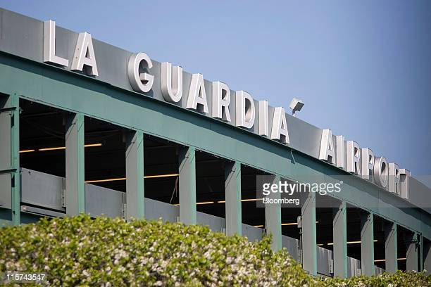 LaGuardia Airport signage is displayed on a parking garage in the Queens borough of New York, U.S., on Monday, April 25, 2011. American Airlines Inc....