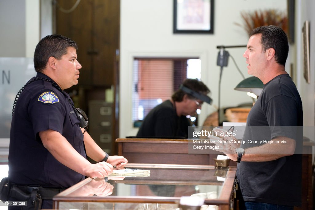 Laguna Beach Police Officer Zach Martinez talks with jewelry store