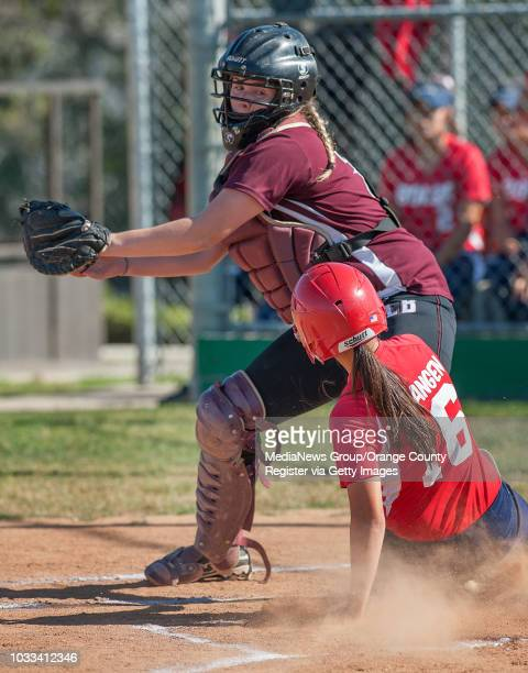 Laguna Beach's catcher Makena Collins top makes the catch on the throw to home just as Bolsa Grande's Alena Guidangen slides home ///ADDITIONAL...
