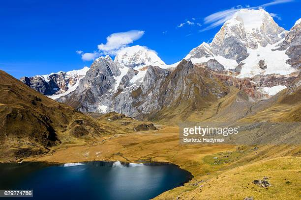 laguna carhuacocha in peruvian andes, south america - peru stock pictures, royalty-free photos & images