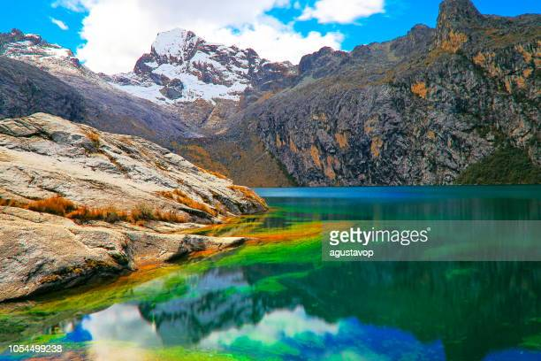 laguna churup and cordillera blanca (long exposure) - ancash andes, peru - emerald green stock pictures, royalty-free photos & images